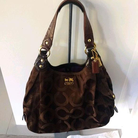 Beautiful  brown bag by Coach 🍀🌸🌼